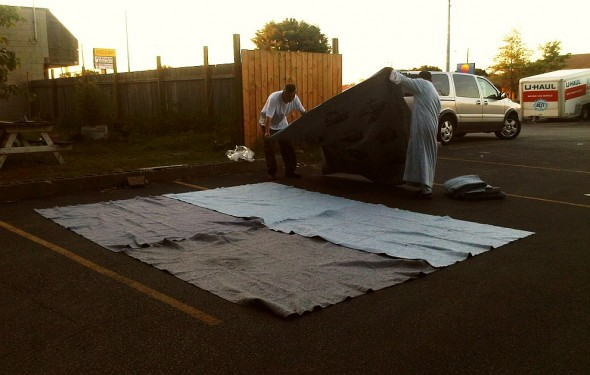Hassan and Bilal spread fifth U-Haul moving blankets as Chatham Maghrib Prayer space - Saturday July 13 2013