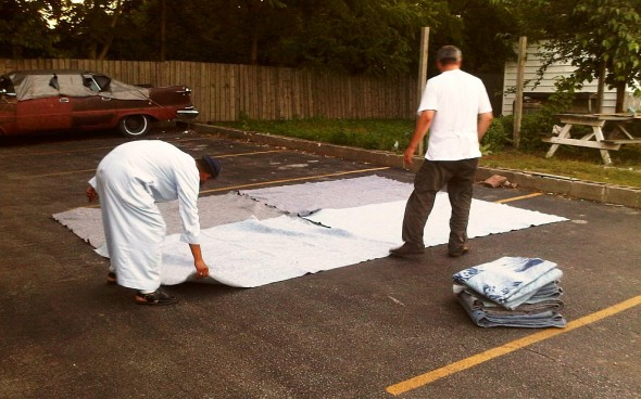 Hassan and Bilal spread fourth U-Haul moving blankets as Chatham Maghrib Prayer space - Saturday July 13 2013