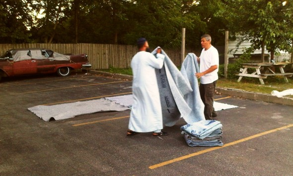 Hassan and Bilal spreading U-Haul moving blankets as Chatham Maghrib Prayer space - Saturday July 13 2013