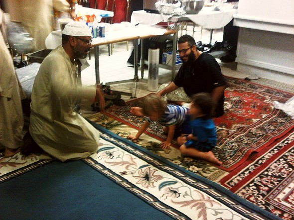 Young Abdul Ghani plays with grown-ups after Iftar, Chatham - Saturday July 13 2013