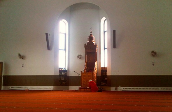10 - Sitting and Reading Qur'an in front of Mimbar, Ottawa Main Mosque, Jumah Friday August 2 2013