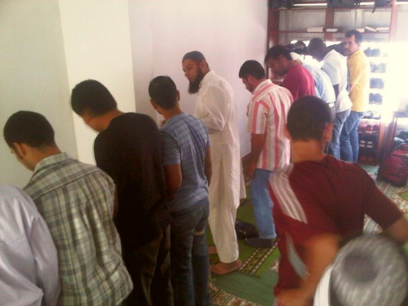 Azar today's Muezzin ensuring the line is straight before Salat al Jumah Friday Prayer is performed Masjid in Medellin Colombia 2014-03-21-50023