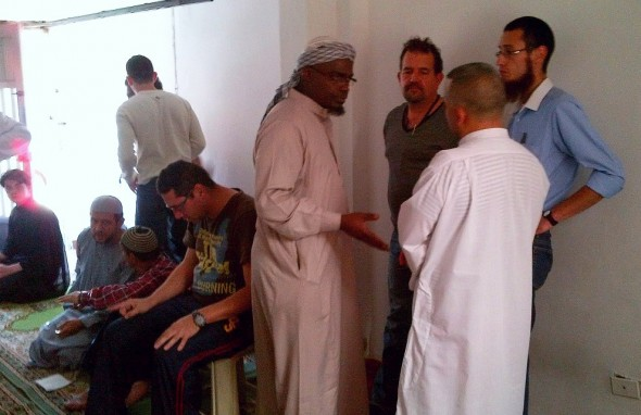 Brother Abdul Haq chatting with brothers inside Medellin's Only Masjid after Salat al Jumah Friday March 28 2014