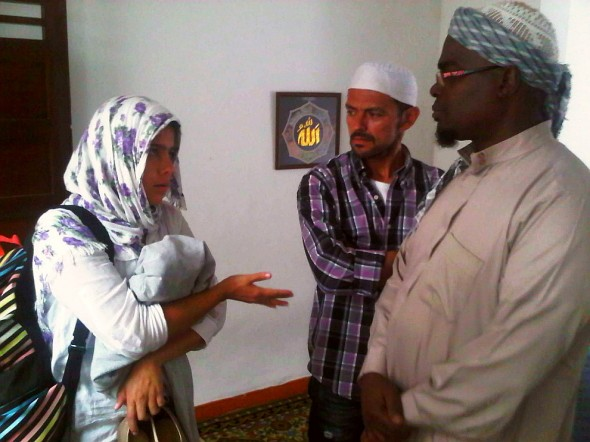 Mariana asking and learning about Muslim Community in Medellin Colombia from Brother Abdul Haq inside Masjid after Salat al Jumah Friday Prayer 2014-03-21-50031