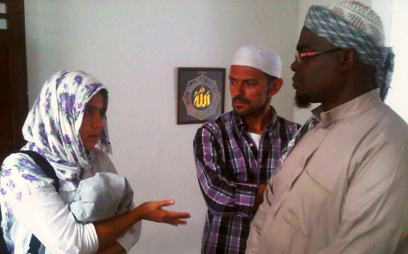 Mariana asking and learning about Muslim Community in Medellin Colombia from Brother Abdul Haq inside Masjid after Salat al Jumah Friday Prayers 2014-03-21-50031
