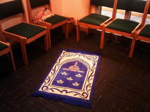 Prayer Mat opened on floor of Charlotte Douglas Airport Chapel 2014-03-16-49193