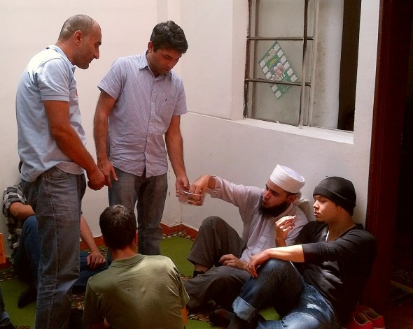 Sharing a plastic bucket of pitted dates after Salat al Jumah in Medellin's Only Masjid Friday March 28 2014