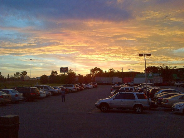 Sunset beyond TARIC Islamic Centre Parking Lot