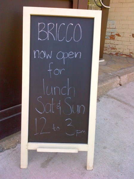 bricco kitchen and wine bar at 3047 dundas street west toronto sidewalk sandwich board in the junction